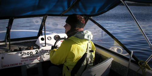 Nicola Temple driving the boat, in the field